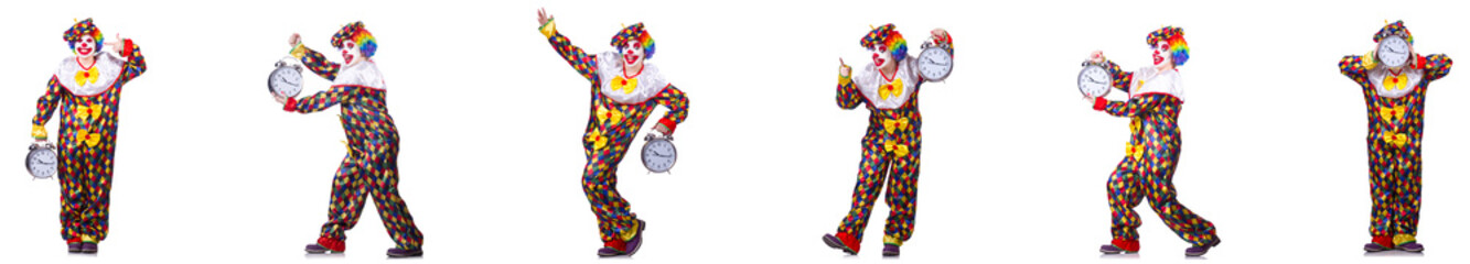 Funny male clown with alarm-clock