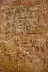 Egyptian ancient hieroglyphs on the stone wall