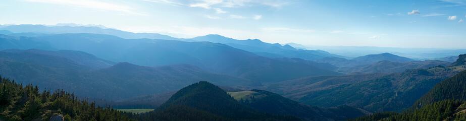 Hazy sun over the mountains peaks