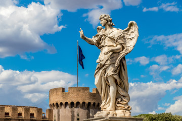 Statue of an angel on the background Castle Sant'Angelo and flag of european union, Rome, Italy
