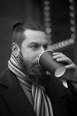 man with a beard drinking coffee