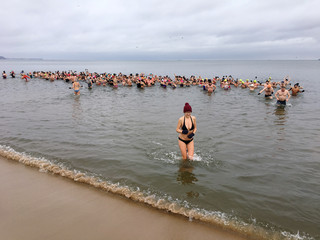 People bathe in the Baltic sea during a group winter exercise in Gdansk