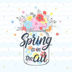 Spring card with maison jar,hand drawn lettering - spring is in the air, floral elements,leaves and flowers. Seasons greetings card perfect for prints, flyers,banners,invitations and more.
