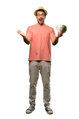 Man holding many bills presenting and inviting to come with hand on isolated white background