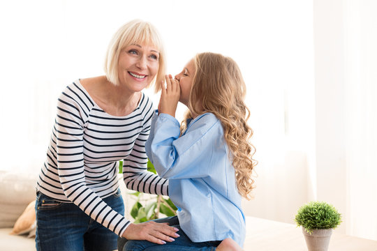 I trust you. Girl telling her grandmother secret