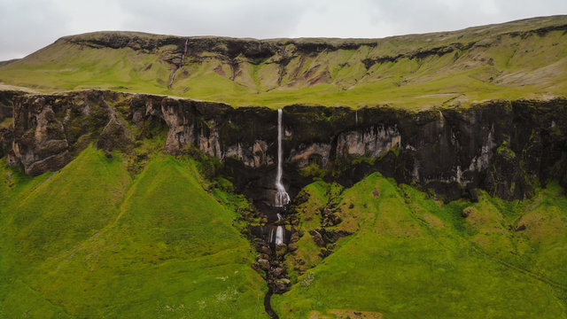 Panoramic landscape Foss a Sidu (Foss á Siðu) waterfall, Kirkjubæjarklaustur, Iceland. Aerial view shot by drone camera.