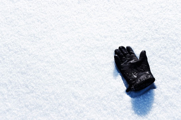 Warm glove on the snow in winter.