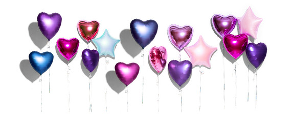 Air balloons. Bunch of purple heart shaped foil balloons, isolated on white background. Valentine's day background