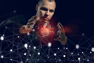The projection currency is dollar and the concept of making. A man on a black background plays with his hands with futuristic objects. Unreal IT presentation background.