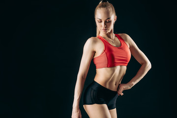 Fitness femal with muscular beautiful ideal body, abdominals. close up photo. copy space. beauty of body