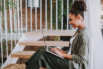 Beautiful afro american girl working on laptop