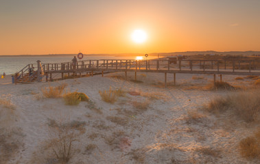 Sunset at the end of a beach day at Praia dos Tres Irmaos in Alvor at the Algarve Coast near Lagos