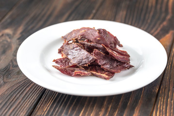 Beef jerky on the white plate