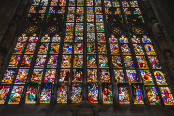 MILAN, ITALY - AUGUST 18 2018: Giant colorful window of Milano Duomo Cathedral with apostolic depictions