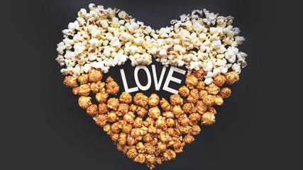 Love Cinema concept of popcorn arranged in a heart shape. Assorted popcorn