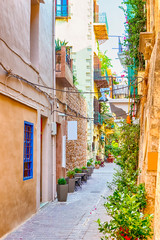 Aluminium Prints Tuscany Tranquil and Empty Street of Chania at Summer Time with Colorful Shutters At Windows in Crete, Greece.