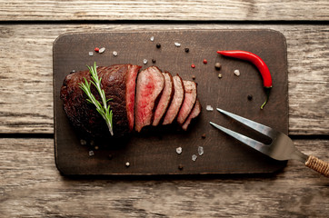 beef steak on a cutting board. on wooden background
