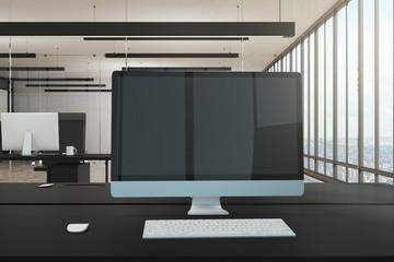 Office desktop with empty computer