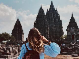 Beautiful woman enjoying the view of Prambanan temple in Yogyakarta.