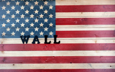 Vintage wooden United States flag with letters spelling wall for border concept