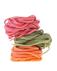 Colorful raw italian pasta isolated on white background