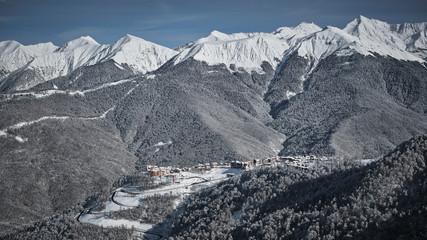 Panoramic view of Rosa Khutor, Krasnaya Polyana, Sochi. Aerial photography with copter. Snow in the mountains, skiing and snowboarding. Winter vacation.