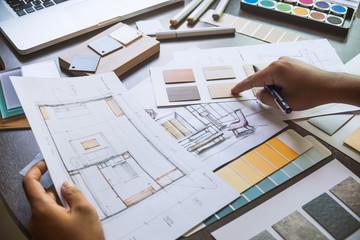 Architect designer Interior creative working hand drawing sketch plan blue print selection material color samples art tools Design Studio Wall mural