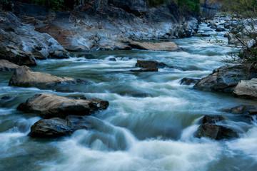 Fototapeta creek flowing over the rocks obraz