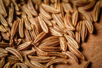 Dry cumin seeds or caraway. Extreme macro photography.