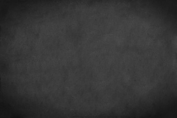 Dark grey paper background. Dark grey texture