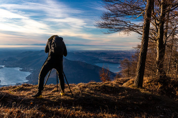 landscape photographer in action - mountain hiking