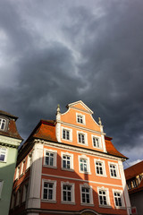 Wall Murals historical city facades on a stormy day