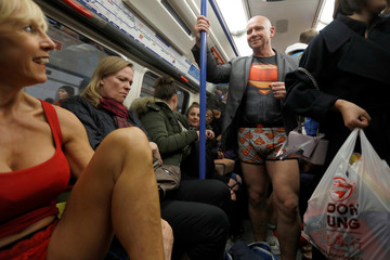 Participants in the No Trousers Tube Ride 2019 mingle with other passengers on the London Underground