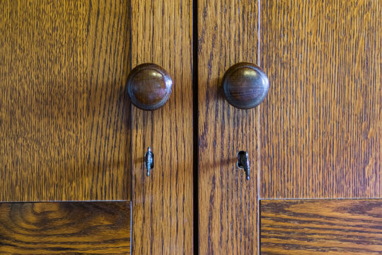 vintage wooden doors of a wardrobe with knobs and keys