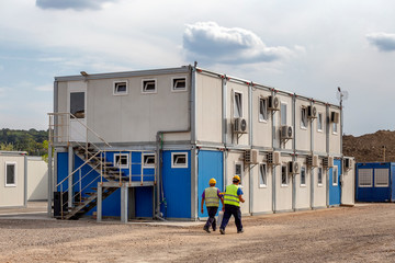 Workers at mobile containers and cabins base