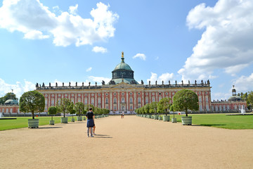 POTSDAM, GERMANY. The new palace and Hauptallee in sunny day. Park of San Sushi