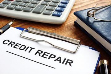 Credit repair form in a clipboard. Bad credit score.