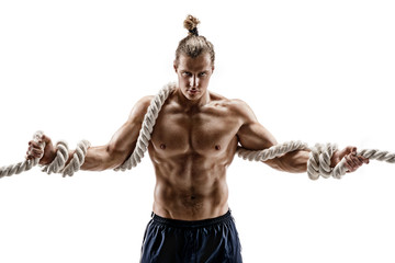 Handsome man with heavy ropes. Photo of attractive man shirtless isolated on white background. Strength and motivation.