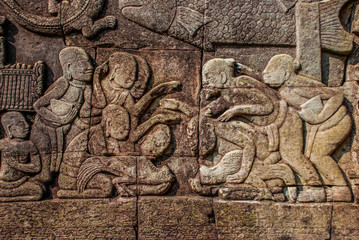Placing bets on their roosters carved on the walls of Angkor Wat
