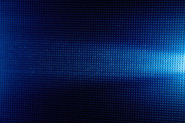 Horizontal beam of white light on a blue background to a black dot