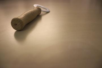 bottle opener on wooden table