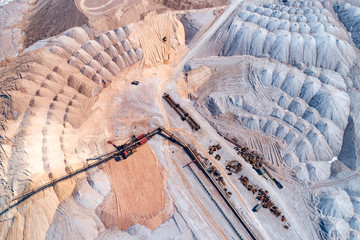 A large pile of unused rock, industrial storage of loose materials. Aerial view