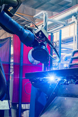 Welding robot in the process. Modern welding production