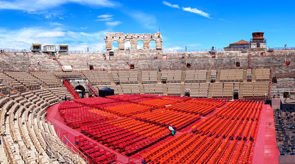 Foto op Textielframe Stadion Inside of Arena of Verona in Italy / Red seats under blue sky in the theater