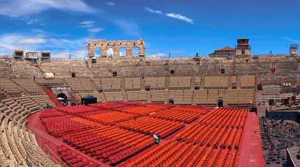 Spoed Fotobehang Stadion Inside of Arena of Verona in Italy / Red seats under blue sky in the theater