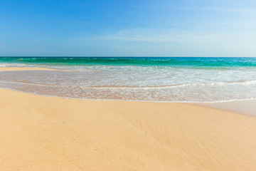 Untouched tropical beach in Sri Lanka with white sand and blue water