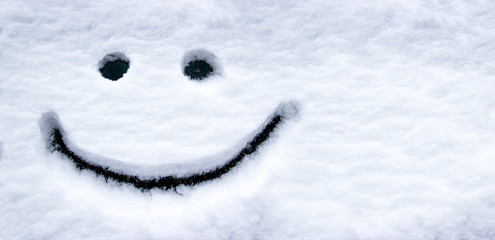 smiling face in the snow eyes and mouth smile