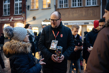 Gdansk's Mayor Pawel Adamowicz speaks with people as he collects money for the Great Orchestra of Christmas Charity in Gdansk