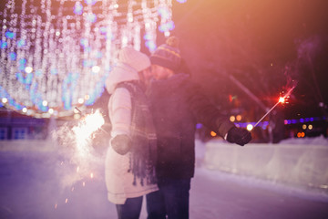 Date lovers in winter rink skates. Concept of Christmas holidays, caring for your loved one