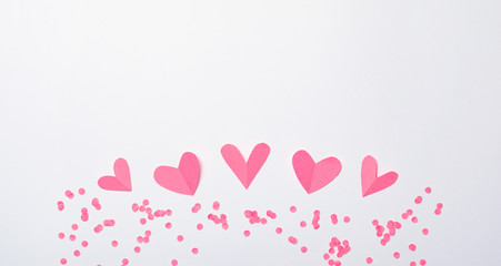 Pink Hearts on White Background, Top View